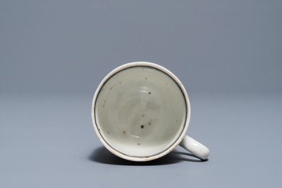 A Chinese grisaille and gilt cup and saucer with a large ship, Yongzheng/Qianlong