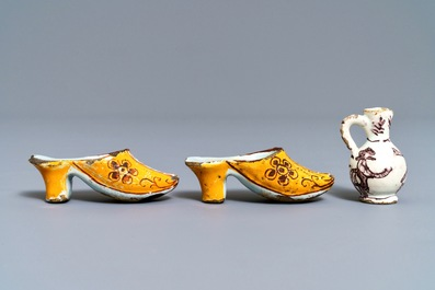A pair of Dutch Delft polychrome slippers, a miniature jug and a fine lid, 18th C.