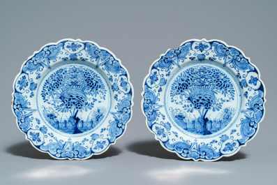 A pair of Dutch Delft blue and white plates, three cups and a saucer, 18th C.