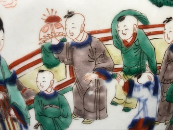 A Chinese wucai baluster vase and cover with playing boys, Transitional period