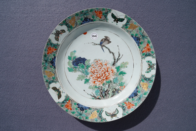 A Chinese famille verte charger with a bird, flowers and butterflies, Kangxi