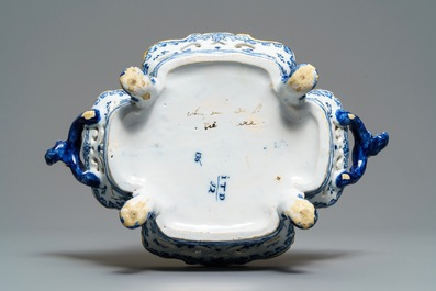 A reticulated Dutch Delft blue and white basket with a view on a wine cellar, 18th C.