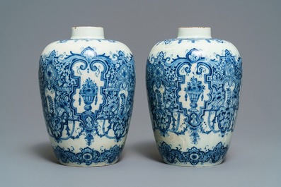 A pair of Dutch Delft blue and white Daniel Marot style vases, early 18th C.