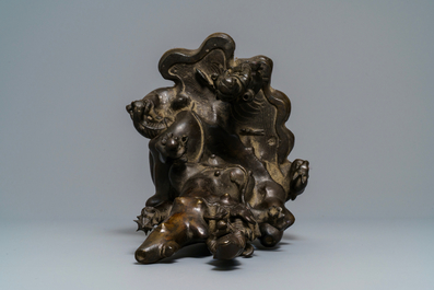 A large Chinese bronze group with Guanyin with child on a rock, Ming