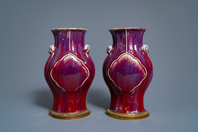 A pair of Chinese flambé-glazed vases on gilt bronze stands, 18/19th C.