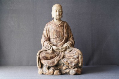A large Chinese painted wood figure of a Buddhist monk, Ming