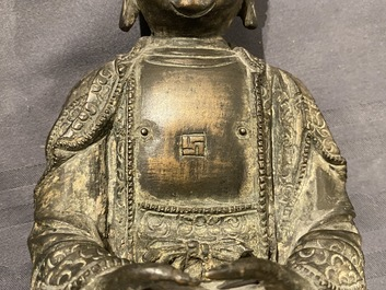 A Chinese bronze figure of Buddha on a lotus throne, Ming