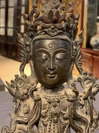 A Chinese bronze figure of Guanyin on a qilin, Ming
