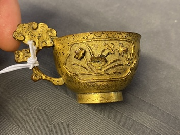 A Chinese relief-decorated gilt bronze cup, Ming