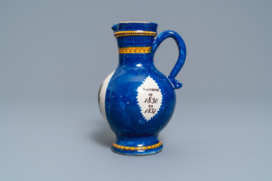 A polychrome Brussels faience commemorative 'musical design' jug, 19th C.