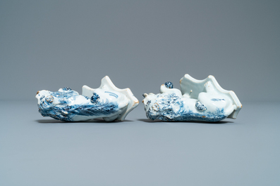 A pair of Dutch Delft blue and white models of lions, 18th C.