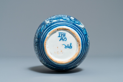 A Dutch Delft blue and white barrel-shaped gin flask with chinoiserie design, dated 1711