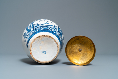 A Dutch Delft blue and white tobacco jar with American Indians and inscribed 'Tonka', 18th C.
