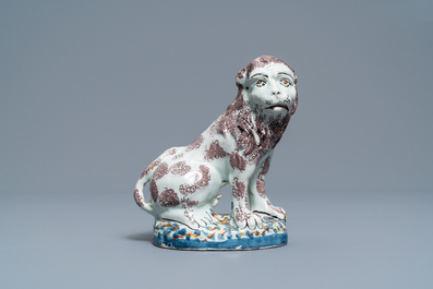 A polychrome Brussels or Lille faience model of a lion, late 18th C.