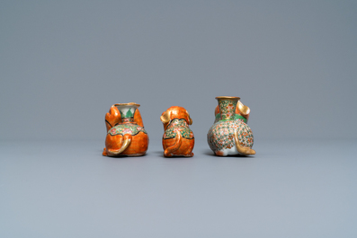 Three Chinese Canton famille rose models of dogs, two with candle holders, 19th C.