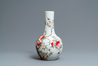 A Chinese famille rose 'nine peaches' bottle vase, Guangxu mark, 19/20th C.