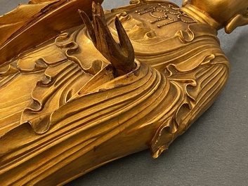 A Chinese gilt and laquered wooden figure of Buddha, 18/19th C.