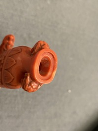 A Chinese carved red coral snuff bottle with a vase resting on a tortoise, Republic