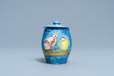 A polychrome Brussels faience mustard jar and cover with a cat, 18th C.