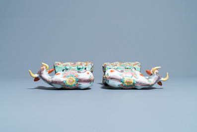 A pair of polychrome petit feu and gilded Dutch Delft models of cows, 1st half 18th C.