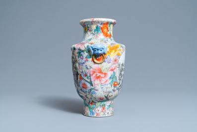 A Chinese famille rose millefleurs vase with grisaille landscape panels, Qianlong mark, Republic