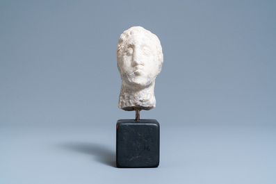 A carved stone head of a man, probably France, 15th C.