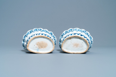 A pair of blue and white French faience bouquetières or wall flower holders, Lille, 18th C.
