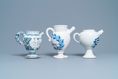 Three blue and white Dutch Delft, Nevers and Rouen wet drug jars and four jugs, 17/18th C.