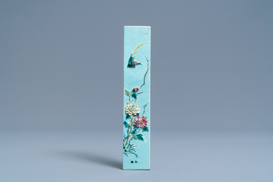 A Chinese famille rose relief-decorated scroll weight, hall mark, 19th C.