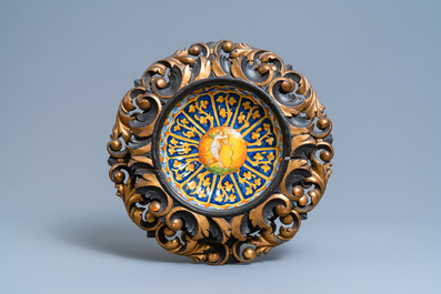 Two polychrome Italian maiolica crespina in finely carved wooden frames, Faenza and Montelupo, 16/17th C.