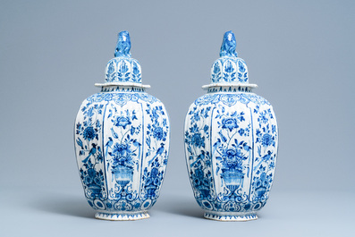 A pair of large Dutch Delft blue and white vases and covers, 18th C.
