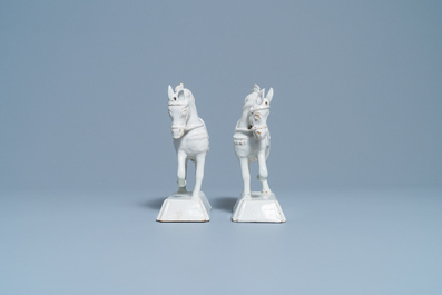 A pair of white Dutch Delftware models of horses, 18th C.
