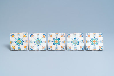 Ten polychrome Dutch Delft tiles with flowers and ornaments, 17th C.