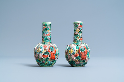 A pair of Chinese reticulated famille verte bottle vases, 19th C.