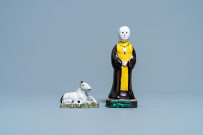 A polychrome Dutch Delft miniature of a horse and a figure of a monk, 18th C.