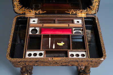 A Chinese parcel-gilt black lacquer sewing table with accessories, Canton, 19th C.