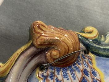 A pair of polychrome Dutch Delft plaques with countryside scenes, 19th C.