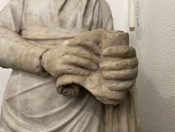 A Roman marble statue of a philosopher holding a parchment roll, ca. 2nd C.