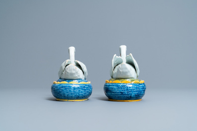 A pair of polychrome Dutch Delft 'swan' butter tubs and covers, 18th C.
