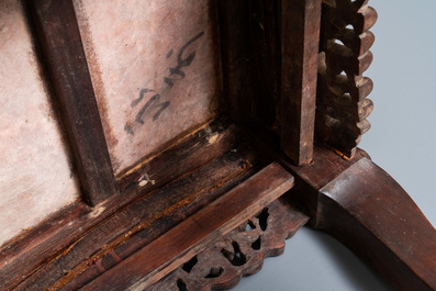 A Chinese carved wooden stand with marble top, 19th C.