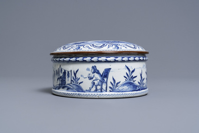 A round Dutch Delft blue and white box and cover with tobacco harvesting scenes, 18th C.