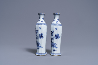 A pair of Dutch Delft blue and white vases and a 'peacock's tail' plate, 18th C.