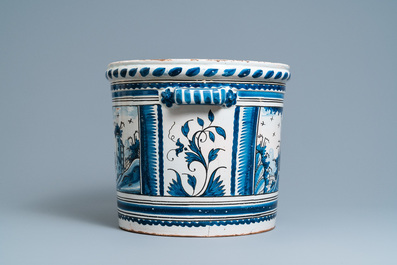 A large blue, white and manganese 'landscape' jardinière, Nevers, France, 18th C.