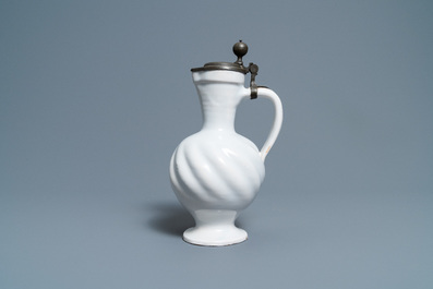 A gadrooned white Dutch Delftware jug with pewter cover, 17th C.