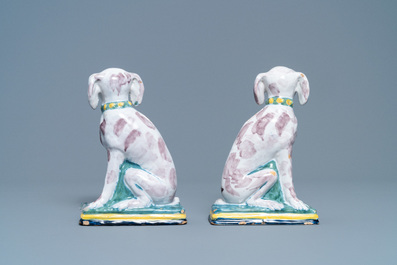 A pair of polychrome Dutch Delft money banks modelled as dogs, 18th C.
