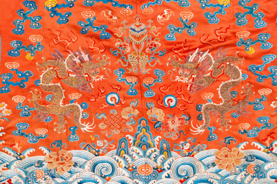 A Chinese embroidered silk red-ground 'dragon' robe, 19th C.