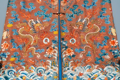 A Chinese embroidered silk brown-ground 'dragon' robe, 18/19th C.