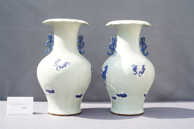 A pair of Chinese blue and white celadon 'horse' vases, 19th C.