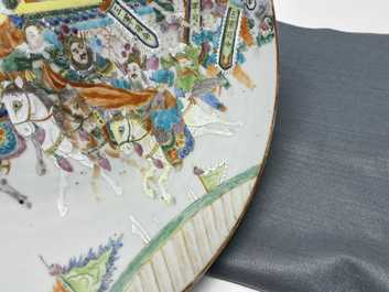 A large Chinese Canton famille rose 'horseriders' dish, 19th C.
