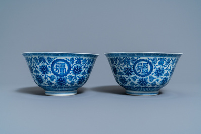 A pair of Chinese blue and white 'wan shou wu jiang' bowls, Qianlong mark and of the period